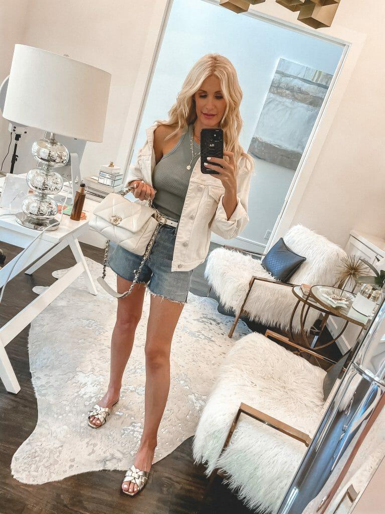 Dallas fashion blogger wearing a white denim jacket and a blue tank