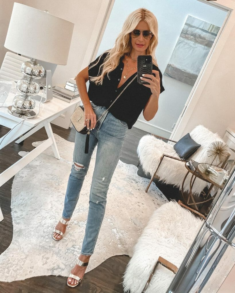 Dallas style blogger wearing a black short-sleeve shirt and gold heels