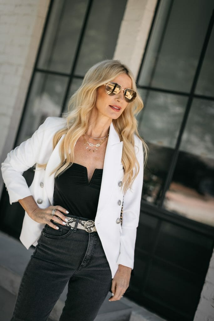 Dallas blogger wearing a chic white jacket and a black bodysuit