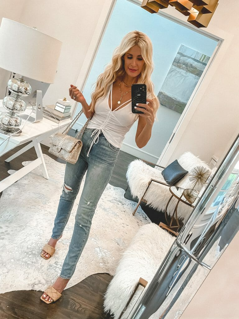 Dallas style blogger wearing a white summer top and straight leg denim