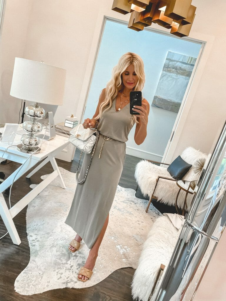 Dallas blogger So Heather wearing a sage green maxi dress and a gold chain belt