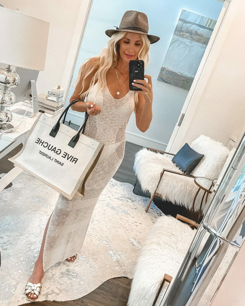 Dallas blogger wearing a sheer white coverup and a bag for summer