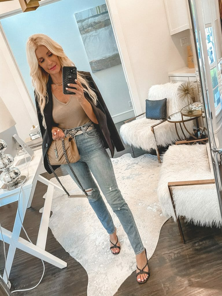 So Heather Blog wearing a neutral v-neck top and a black blazer jacket