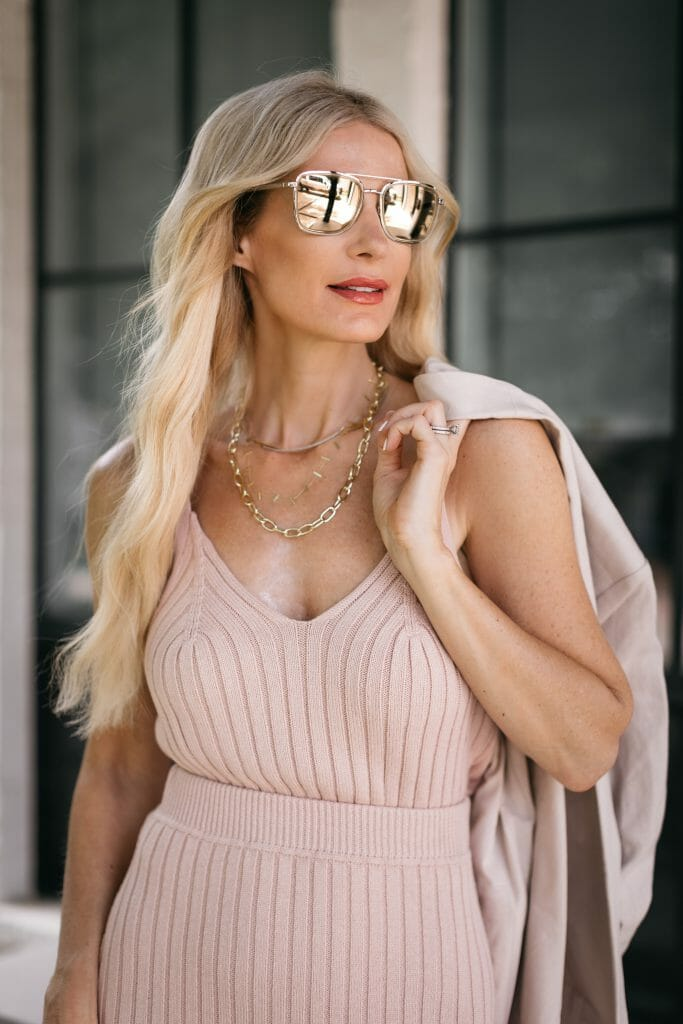 Style blogger wearing a knit tank and gold chain necklaces