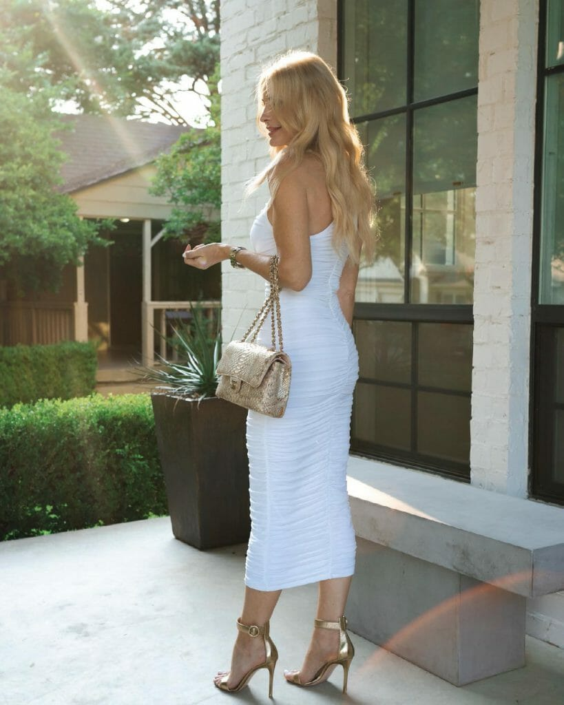Dallas fashion blogger wearing a white ruched dress from intermix