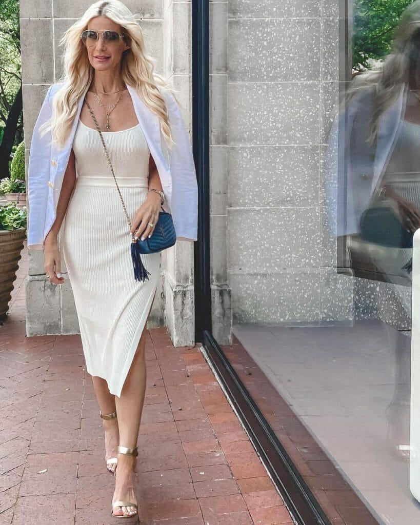 Dallas style blogger wearing a cream midi dress and a white blazer