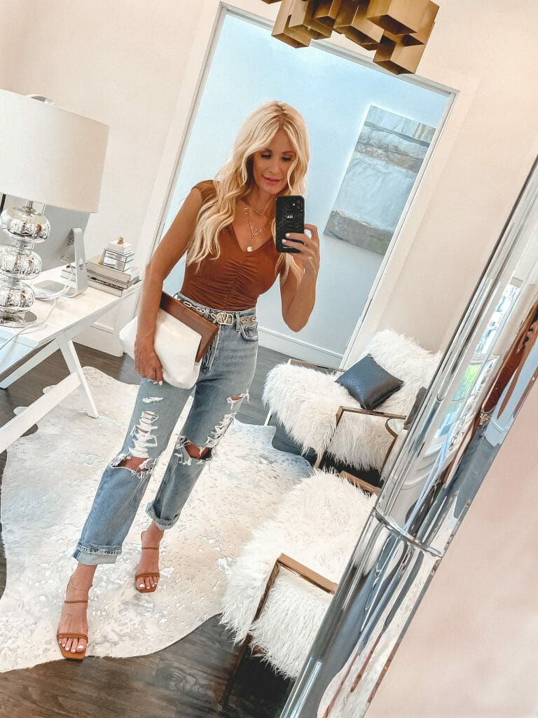 Dallas Fashion Blogger wearing a ruched rust tank top and distressed denim