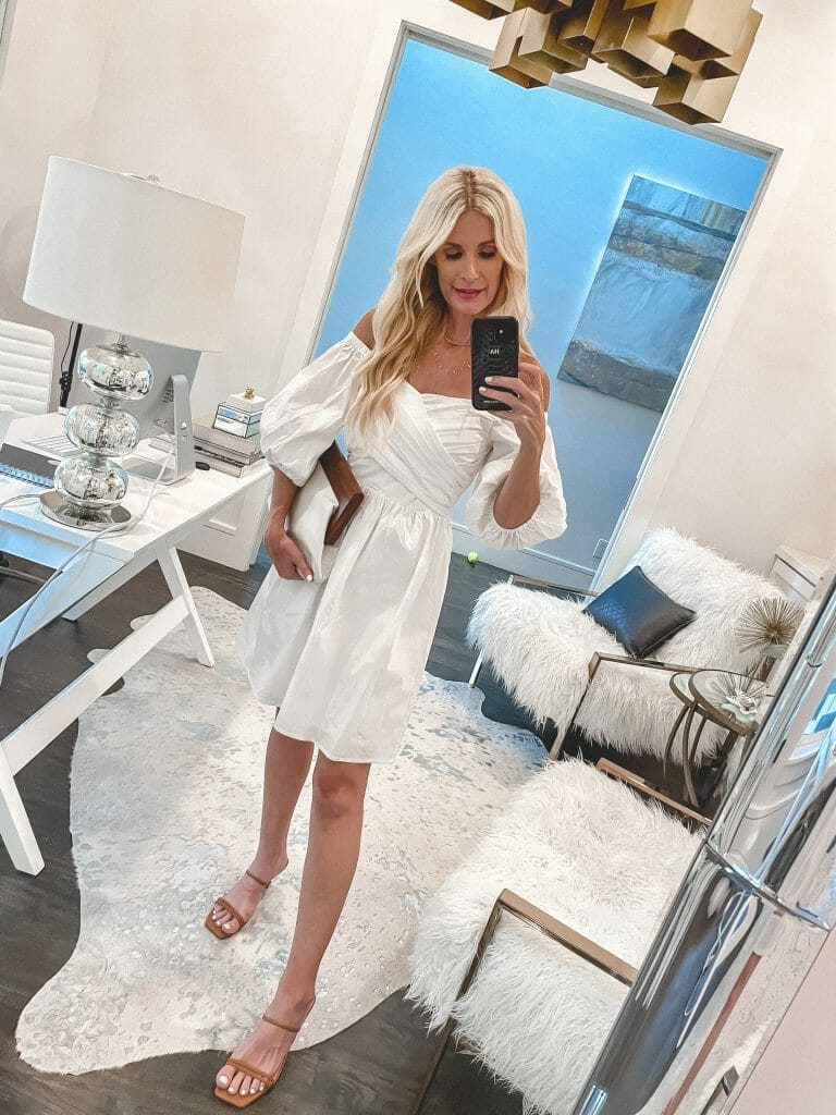 Dallas blogger wearing a strapless white dress and camel heels