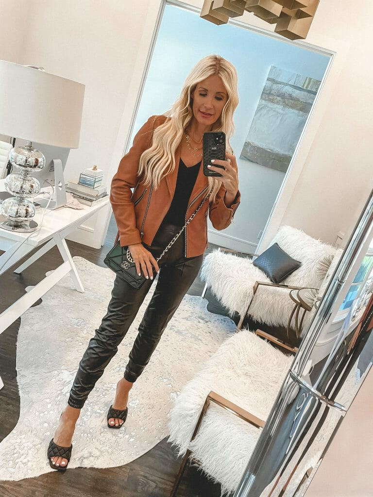 Dallas Fashion Blogger wearing a rust colored Moto jacket and a faux leather leggings