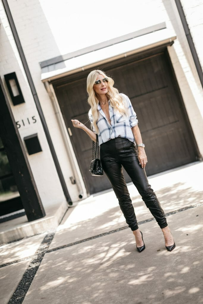 Dallas blogger wearing a white and blue button down and faux leather leggings