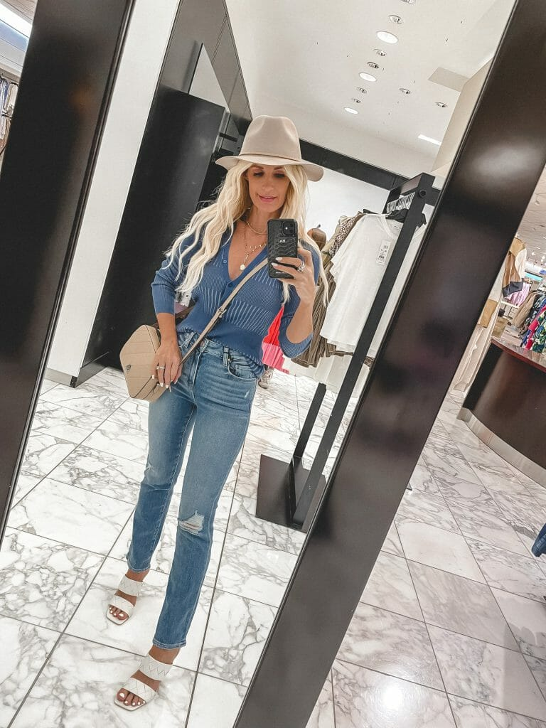 Dallas style blogger wearing a blue cardigan and blue jeans