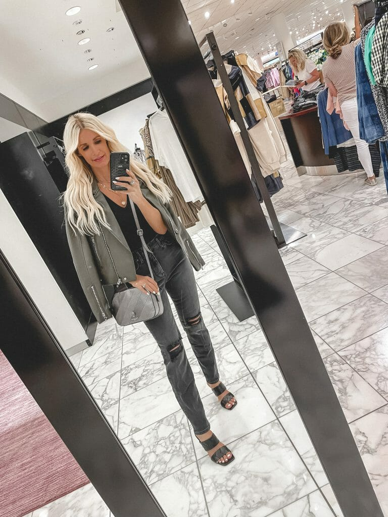Dallas Fashion Blogger wearing a faux leather jacket and black denim